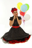 Retro woman with balloons Stock Photo