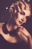 Retro woman with beautiful hairdo Stock Image