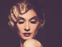 Retro woman with beautiful hairdo Royalty Free Stock Image