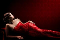 Retro Woman Beauty in Elegant Red Sexy Lace Dress, Beautiful Fashion Model Lying