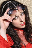 Retro Woman with Big Sunglasses. Retro hipster woman face portait outdoors. 70s style girl raising sunglasses Stock Photos