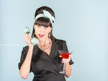 Retro Woman in Black Dress with Cosmopolitan and Phone Receiver Stock Photos
