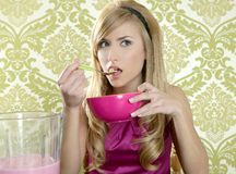Retro woman breakfast eating corn flakes Royalty Free Stock Photo