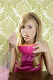 Retro woman breakfast eating corn flakes Royalty Free Stock Photos
