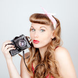 Retro woman with camera Stock Image
