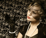 Retro Woman with Cigar. Portrait of Fashion Beautiful Blonde. Stock Photography