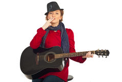 Retro woman with cigarette and guitar Stock Photography