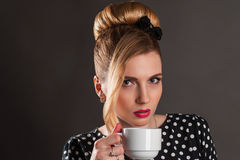 Retro woman with a cup of coffee Stock Photos