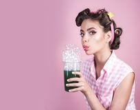 Retro woman drink summer cocktail. pinup girl with fashion hair. perfect housewife. pin up woman with trendy makeup. Pretty girl in vintage style, copy space stock photo
