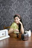 Retro woman drinking cafe on wallpaper kitchen Stock Photos