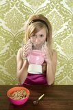 Retro woman drinking strawberry milkshake Stock Photo