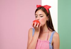 Retro woman eating tomato. vegetarian and organic food. pinup girl with fashion hair. Healthy food and dieting. Farming. Pin up woman with trendy makeup stock image