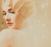 Retro woman. Elegant blond retro woman  in golden dress with beautiful hairdo and red lipstick Stock Image