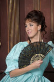 Retro woman with fan Stock Images