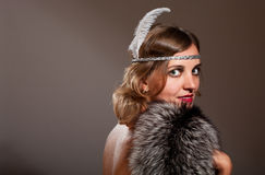 Retro woman with feather and fur Royalty Free Stock Image