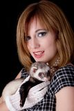 Retro woman and ferret Stock Photos