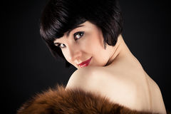 Retro woman with fur Royalty Free Stock Images