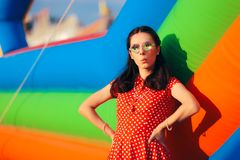 Retro Woman at Garden Party Near Bouncy House royalty free stock image