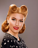 Nostalgia. Styled Smiling Woman with Retro Golden Hair Style. Nobility Royalty Free Stock Image