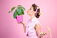 Retro woman growing plants. Garden. pinup girl with fashion hair. greenhouse worker or gardener. spring. pin up woman. With trendy makeup. pretty girl in stock image