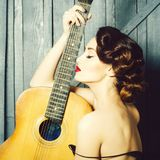 Retro woman with guitar stock photo