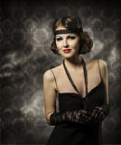 Retro Woman Hairstyle Portrait, Elegant Lady Make Up. With Vintage Hair Style in Fashion Model Black Dress Stock Photo