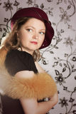 Retro woman in hat and boa. Over glamorous background Royalty Free Stock Photo