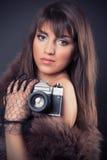 Retro woman holding vintage camera Royalty Free Stock Photography