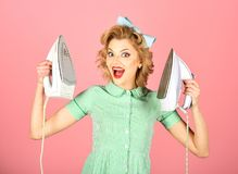 Retro woman ironing clothes, gender inequality. royalty free stock image