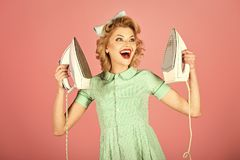 Retro woman ironing clothes, gender inequality. royalty free stock photography
