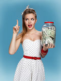 Retro woman with a jar of money having an idea How to Spend Money. Shopping concept Royalty Free Stock Image