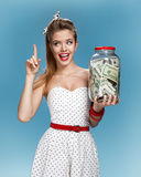 Retro woman with a jar of money having an idea How to Spend Money. Shopping concept Stock Images