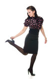Retro woman lifted her leg holds the heel Stock Photo