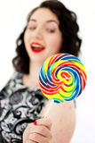 Retro woman with a lollipop Royalty Free Stock Photo