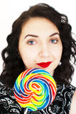 Retro woman with a lollipop Royalty Free Stock Photos