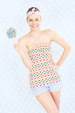 Retro woman with lollipop Stock Photos