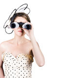 Retro woman looking through binoculars Royalty Free Stock Images