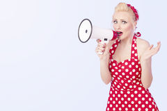 Retro woman with megaphone. Retro woman holding a megaphone stock images