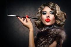 Retro Woman with Mouthpiece. Beauty Retro Woman with Mouthpiece. Vintage Styled Beauty stock image