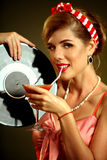 Retro woman with music vinyl record. Pin up girl drink martini cocktail. Royalty Free Stock Photography