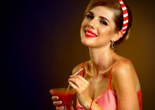 Retro woman with music vinyl record. Pin up girl drink martini cocktail. Stock Image