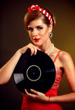 Retro woman with music vinyl record . Pin-up retro female style Royalty Free Stock Image