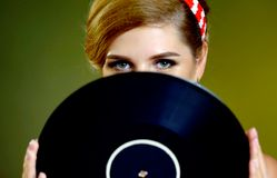 Retro woman with music vinyl record. Pin-up retro female style Royalty Free Stock Photo