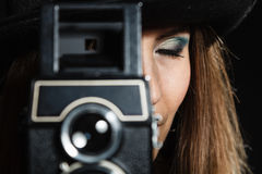Retro woman with old camera. Steampunk. Royalty Free Stock Photo
