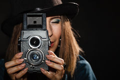 Retro woman with old camera. Steampunk. Stock Image