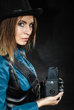 Retro woman with old camera. Steampunk. Stock Photos