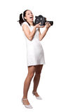 Retro woman with an old camera Royalty Free Stock Photography