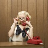 Retro woman on phone royalty free stock photography