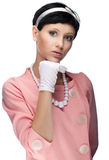 Retro woman in pink dress 60s Stock Image