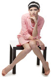 Retro woman in pink dress 60s. Over white background stock photography